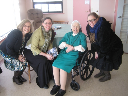 Visiting our dear great-aunt Sr. Zetta on St. Patrick's Day. (Take not of her green habit for the occasion.) She will be 96 years old in one month. She wanted me to autograph her copy of The Scent of Holiness. (That's my mum on the left and my sister on the right).
