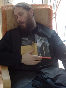Here's a hilarious photo of my brother teasing me, pretending to have fallen asleep while reading my boring book. (This was only intended for private viewings, but a little sister likes to give a little pay back! hehe)