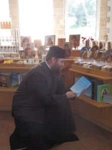 Fr. Matthew showcasing a fantastic book (Abba Dorotheos' Practical Teachings on the Christian Life) in the monastery's lovely boutique.