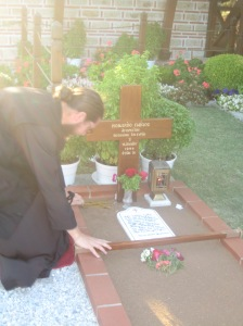 Fr. John venerating the holy saint's grave, 2012.